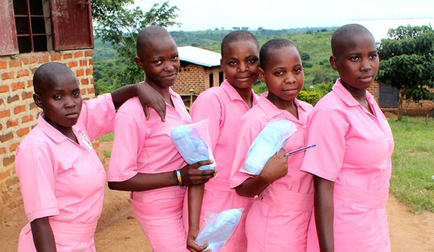 LUCKY ONES: Students from Great Horizon secondary school in Uganda's rural Kyakayege village including Resty Nakawoza (far left) proudly pose with their AFRIPads after a reproductive health presentation.