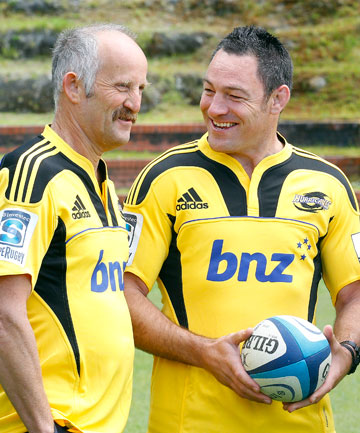 New Hurricanes board member and private shareholder Gareth Morgan, wearing his new jersey, chats with the team's coach, Mark Hammett