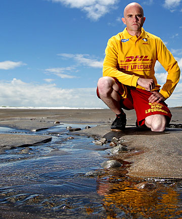 Surf Life Saving club development officer Andy Cronin stands on Fitzroy beach