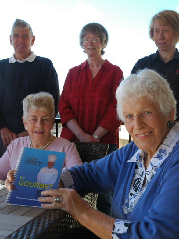 TREASURED TREATS: Recipes passed down through the generations make up  From Grey to Gourmet, a recipe book by residents and staff at Summerset at Aotea retirement village. Clockwise from front right, Pam Schermers, Val Carr, John Naylor,  Margaret Hobbs and Cafe supervisor Susanne Boest.