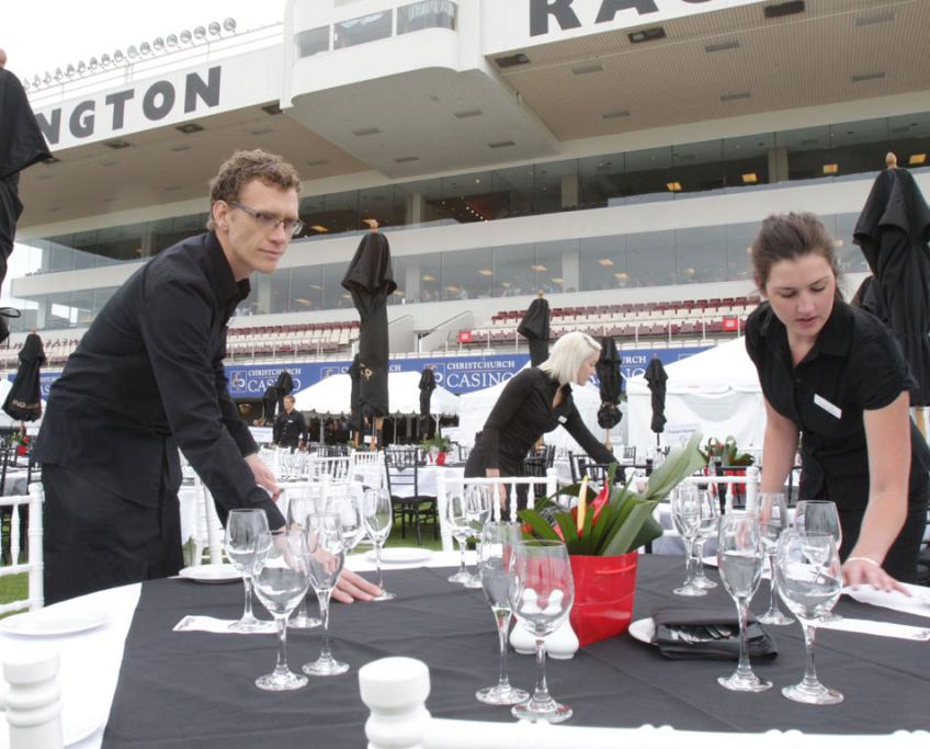 Ron Montgomery left, Pagen Chalklen, and Lynda Wright set tables in the Blanc de Blanc area.
