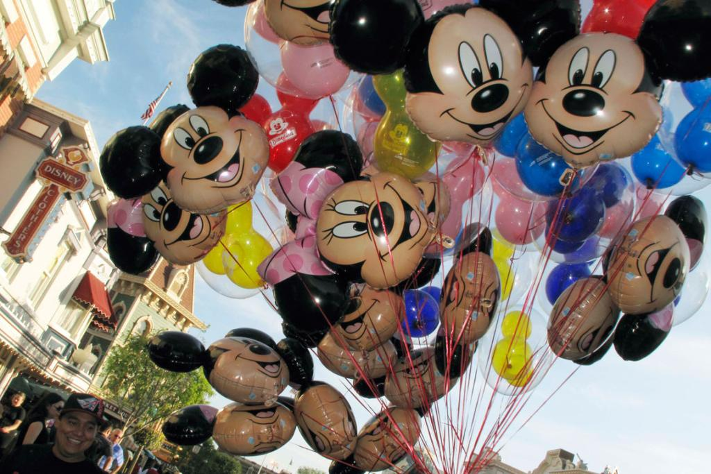 Balloons of Mickey Mouse are carried down main street at Disneyland in Anaheim.