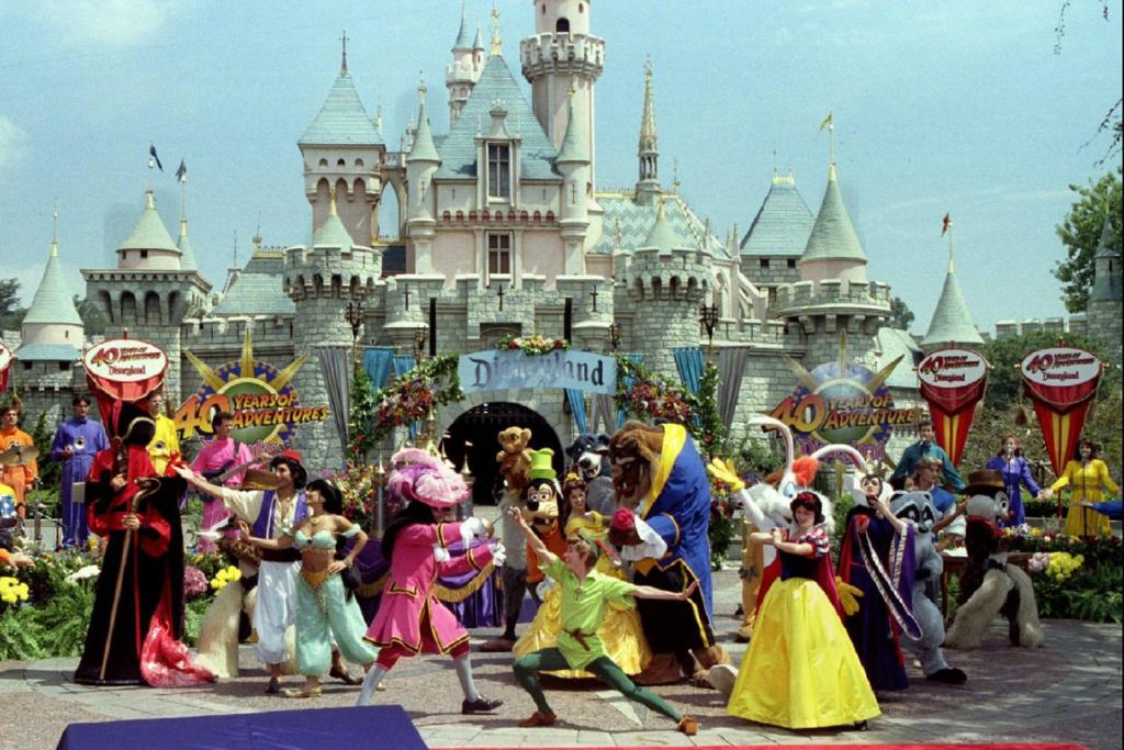Disney characters perform at the Sleeping Beauty Castle.
