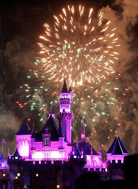Fireworks explode over the Sleeping Beauty Castle.