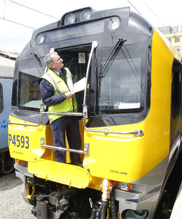 READY TO ROLL: KiwiRail Train Manager Harvey Paterson inspects the last Matangi train to be commissioned at  Wellington Railway Station.