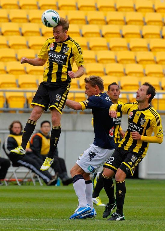 Wellington Phoenix's Alex Smith goes for a header.