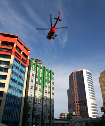 CAREFUL NOW: The helipro helicopter next to the building at 49 Boulcott St.