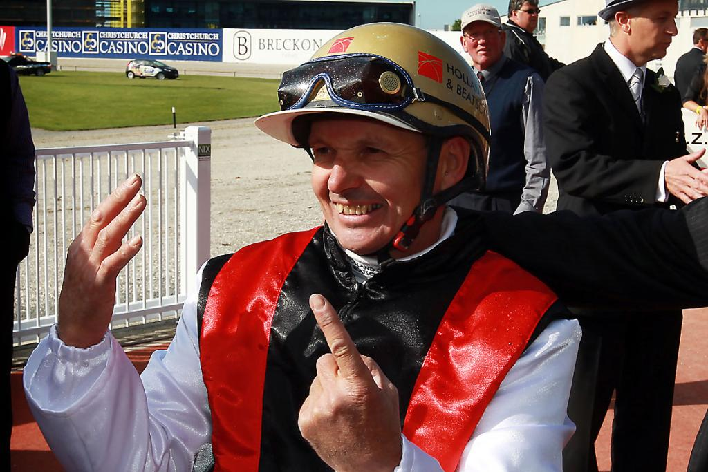 WINNDER: Ricky May holds up six fingers to mark his outstanding six NZ Trotting Cup wins.