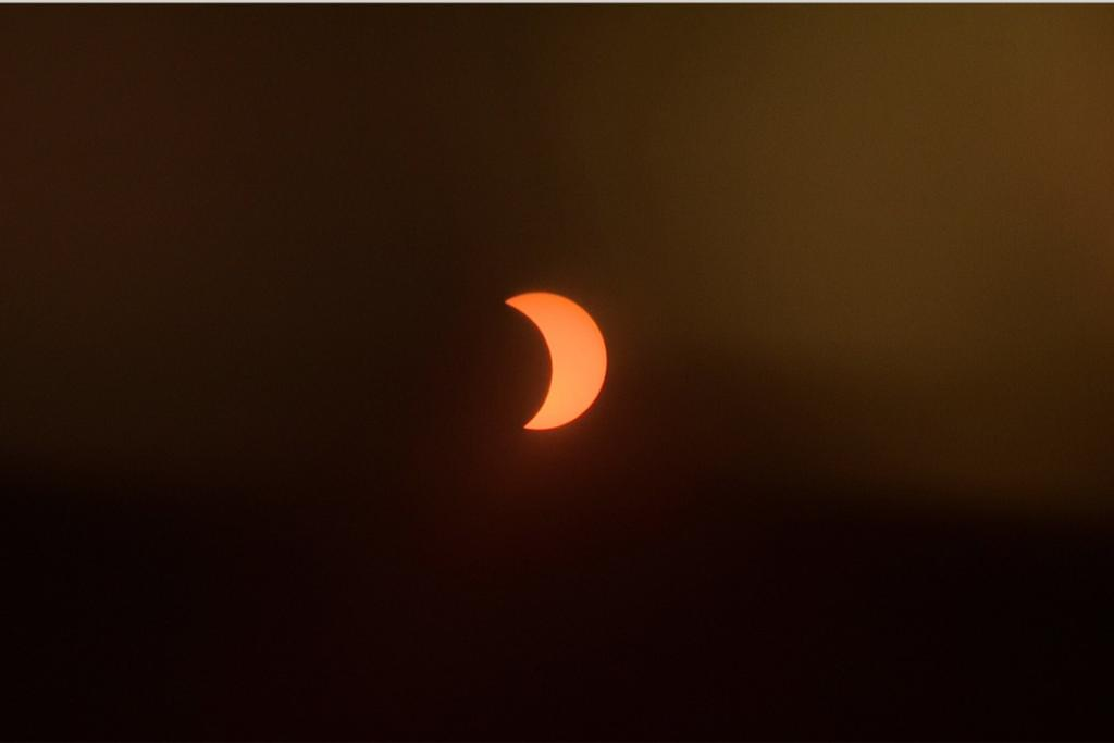 The moon, seen from Wellington, part-way through the partial solar eclipse.