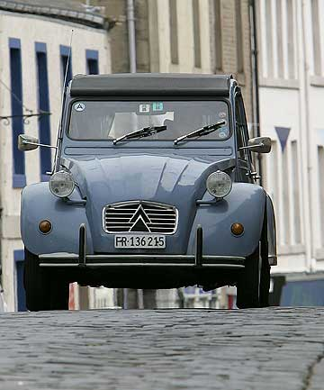 ICONIC: Famous French cars such as the Citroen 2CV could be banned from the streets of Paris under new regulations.