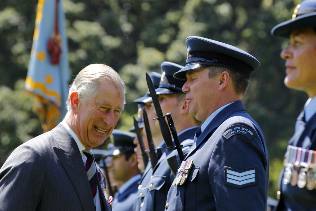 Prince Charles shares a joke with an officer an official ceremony at Government House.