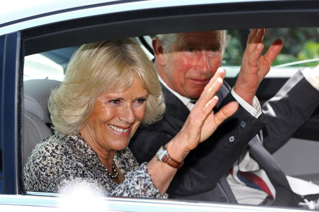 Prince Charles with Camilla leave Government House during their visit to Wellington.