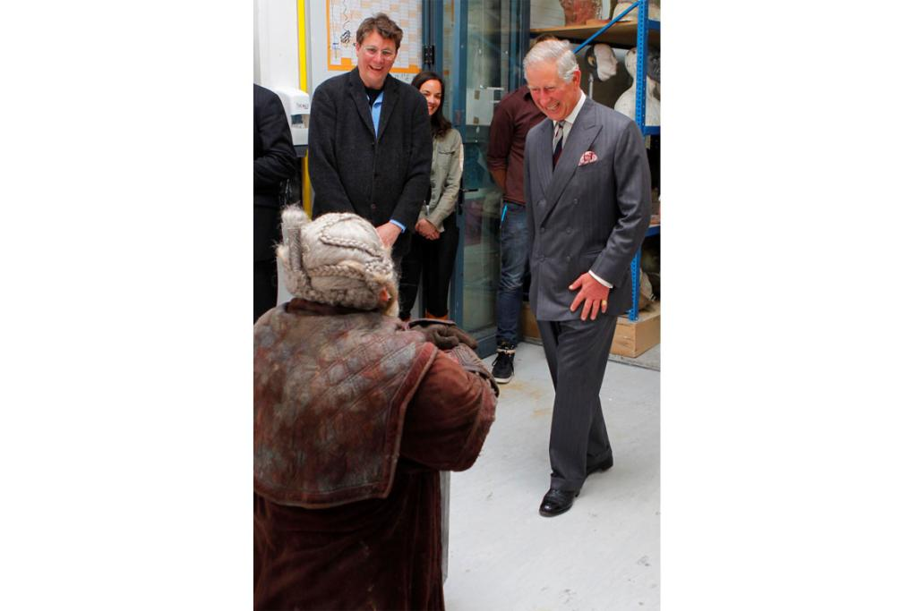 Prince Charles is greeted by The Hobbit actor Mark Hadlow, while Sir Richard Taylor looks on.