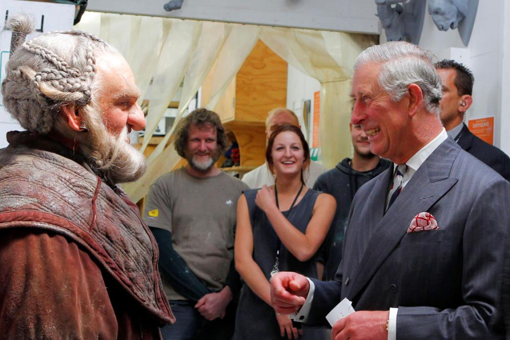 Prince Charles talks with The Hobbit actor Mark Hadlow at the Weta Workshop in Wellington.