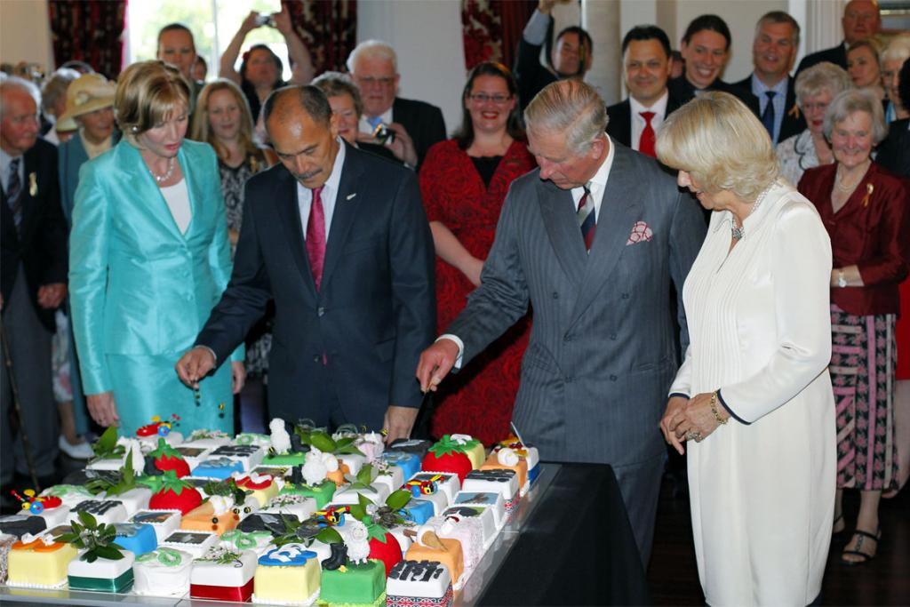 Prince Charles and Camilla with Sir Jerry Mateparae and wife Janine cut into one of 64 kiwiana-themed cakes created for his 64th birthday.