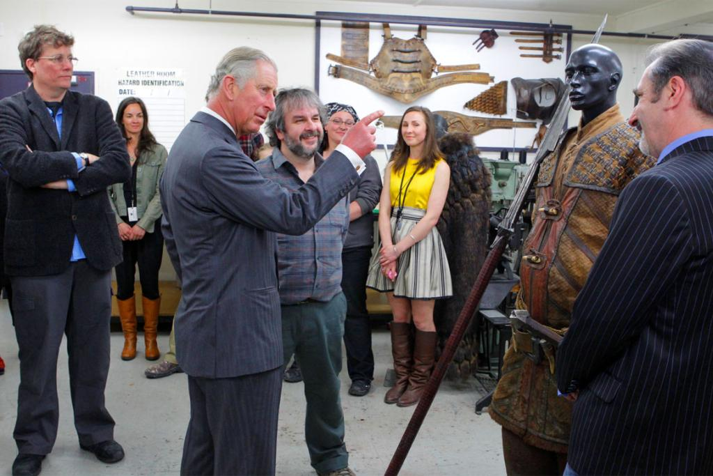 Prince Charles looks Weta Workshop creations with Sir Richard Taylor, left, and Sir Peter Jackson.