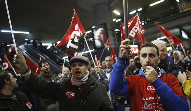WORKERS PROTEST: Picketers from workers' and trade unions shout slogans at Atocha rail station during a 24-hour nationwide general strike in Madrid.
