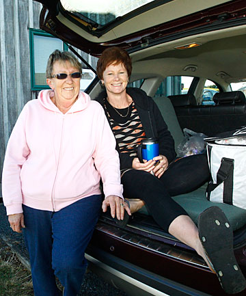 Ann Brown, left, with Carol Dewdney, who queued for 21 hours with husband Brett to secure their slice of paradise