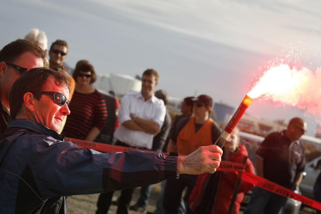 FLARE UP: Port and marine staff participate in a safety drill along Timaru's waterfront.