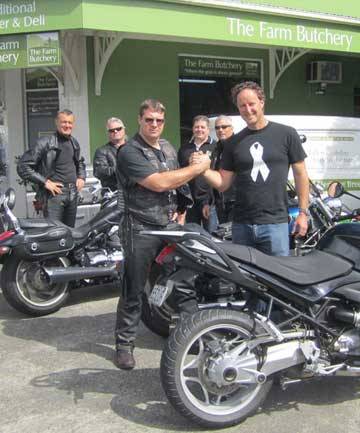 RIBBON RIDE: Warkworth resident Bevan Woodward of Abuse Prevention Services and Kitt Wyatt of the Seeds of Abraham Motorbike Club will be riding with 100 men wearing white ribbon badges in the Orewa New World Santa Parade.