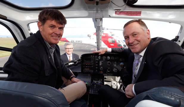 READY FOR TAKEOFF: Prime Minister John Key in the pilot's seat of a HNZ helicopter at Nelson Airport with instructor Dave Sowman and president and CEO of HNZ Group  Don Wall, background.