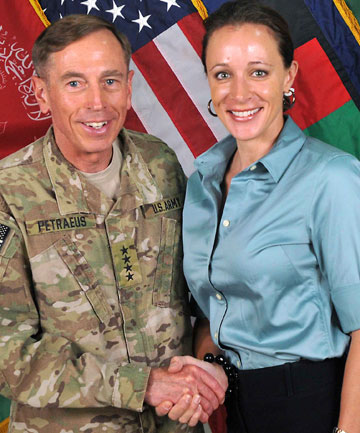 CAUGHT: General David Petraeus and Paula Broadwell shake hands in 2011.