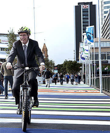 UNDER FIRE: Mayor Len Brown tries out the bike hire scheme during the Rugby World Cup.