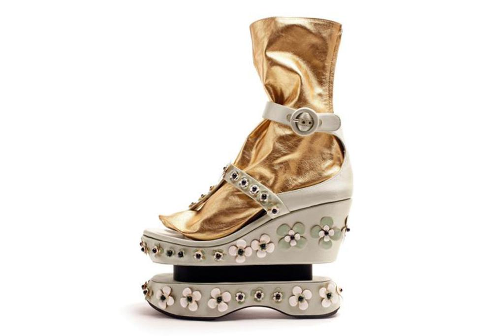 "Prada sandals. ""If you can call them sandals, that is. These mobile works of art have a strong Asian theme and with built-in socks they're just like a Japanese Geisha's shoes - except in metallic gold!"""