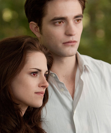 INTO THE SUNSET: Kirsten Stewart and Robert Pattinson take a last bow as Bella and Edward Cullen in Breaking Dawn – Part Two.