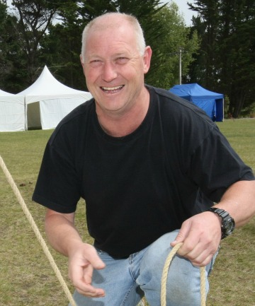 Waihopai Rowing Club president Terry Reeves checking tents set up for the Corpor 8 rowing event tomorrow.