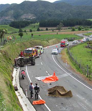 mergency services at the scene of a collision between a motorcycle and a 4x4 vehicle on Takaka Hill highway