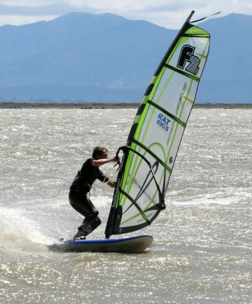 OLYMPIC AMBITION: Tim Fraser-Harris, chief instructor at Nelson Watersports, carves through Nelson Haven at Atawhai.