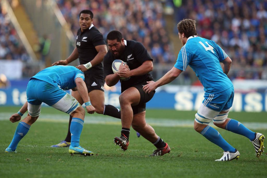 Charlie Faumuina takes the ball forward for the All Blacks.