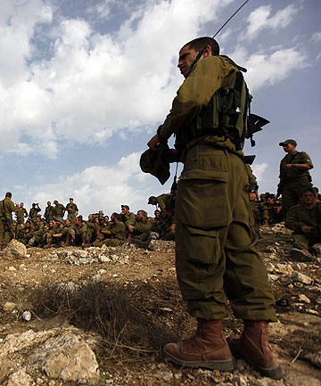PREPARING FOR INVASION: Israeli soldiers take part in a drill simulating a possible ground invasion into the Gaza Strip.