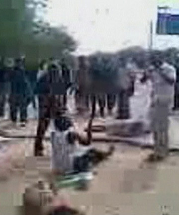 A still image taken from video obtained from a soldier requesting anonymity, shows an unarmed man sitting down on a roadside pleading to his captors in Maiduguri, Nigeria.