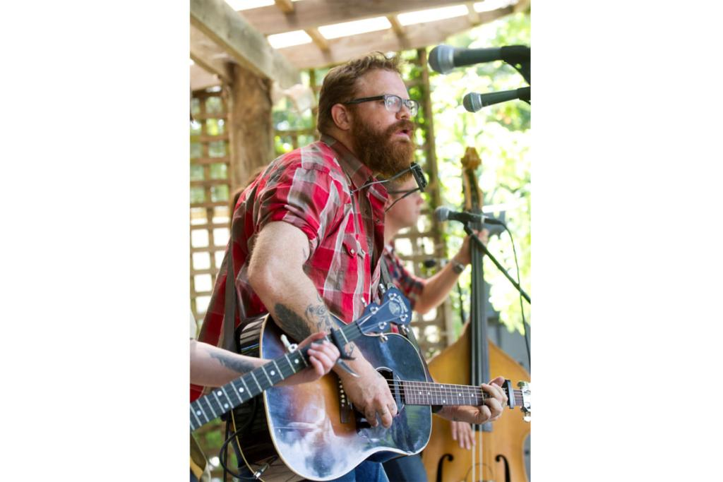 Adam McGrath of The Eastern performs at the Ata Rangi vineyard.