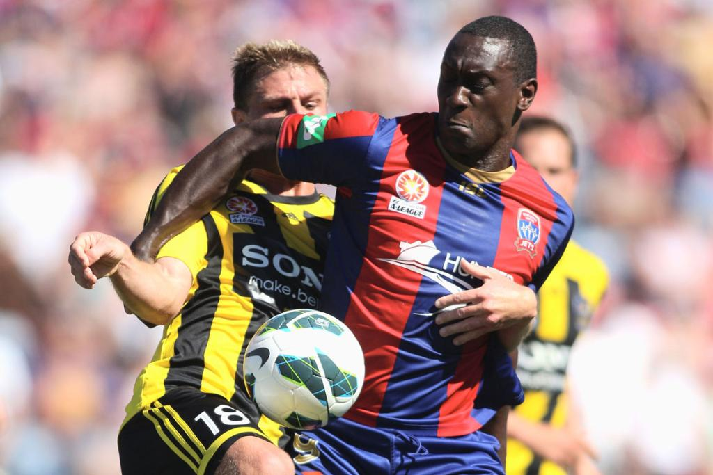 Emile Heskey of the Jets and Ben Sigmund of the Phoenix contest the ball.