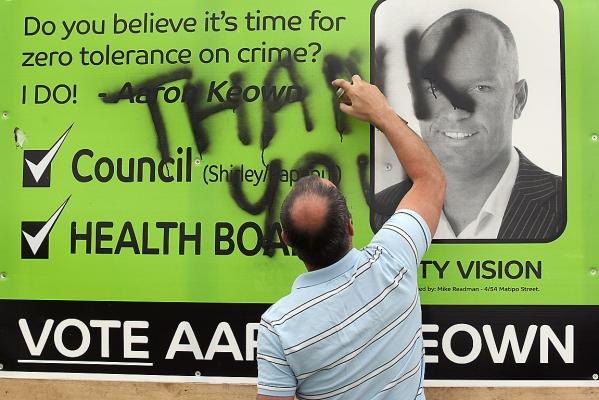 Aaron Keown with his campaign billboard