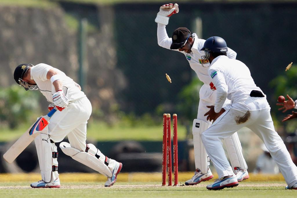 New Zealand's Brendon McCullum is bowled out by Sri Lanka's Rangana Herath.