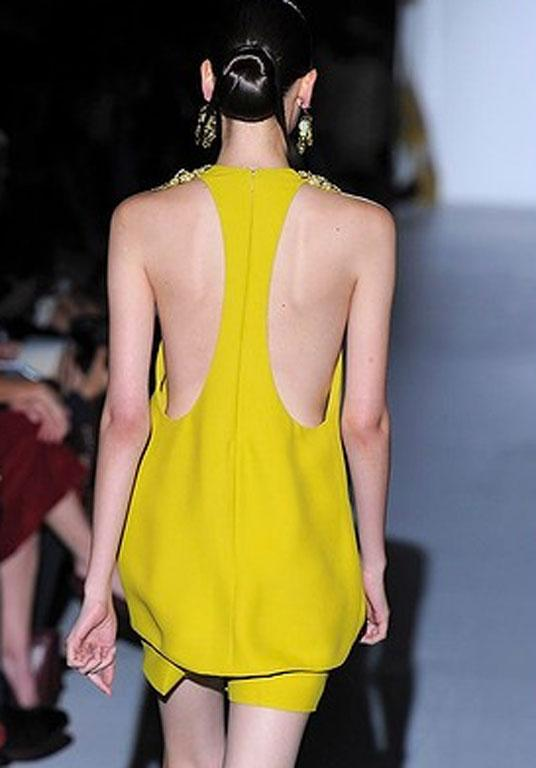 Super slick chignons at the Gucci Spring Summer 2013 fashion show during Milan Fashion Week this year.