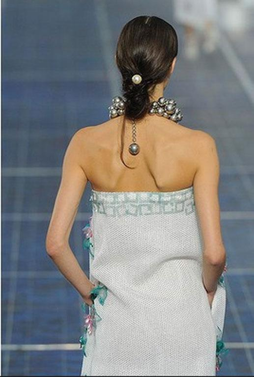 Super pretty lolw chignons at the Chanel Spring Summer 2013 fashion show this year.