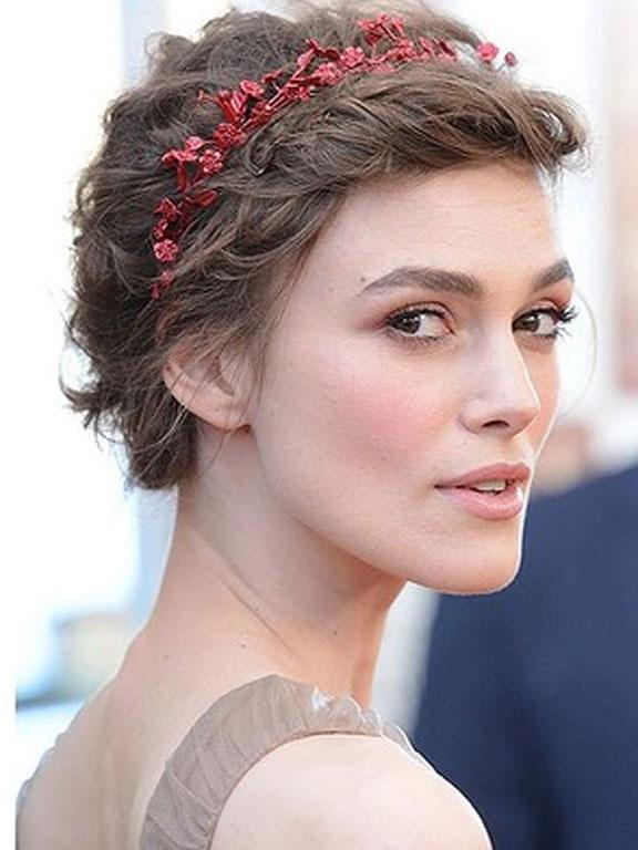 Keira Knightley, again with the lovely bridal hair. This time piled all on her head with what could be tinsel, but works!