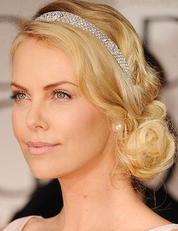 The hairstyle that Charlize Theron wore to the Golden Globes would also work beautifully with a wedding dress. Perfectly simple, slightly messy, and with a dazzling row of diamontes to make it shine.