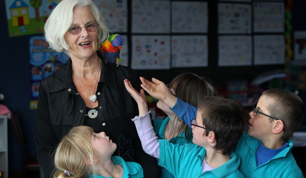 POPULAR PRINCIPAL: Oceanview Heights School principal Jenny Langley shares a moment with the school bird and some of her students.