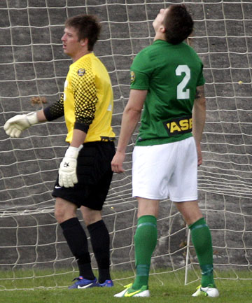 NOT ANOTHER ONE: YoungHeart Manawatu goalie Matt Borren and his team-mates show their despair after another goal by Waitakere United at Memorial Park yesterday.