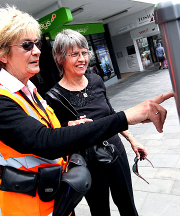 New Plymouth District Council enforcement officer Lyn Adlam gives Tikorangi's Janet Finer a lesson on how to use the city's new parking machines