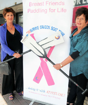 Fashion forward:  Breast cancer survivor dragonboaters Marlene Solomon, left, and Carole Rudman model examples of the fashion wear a pop-up shop  will be selling to help get 24 paddlers from this district  to an international competition in the United States.