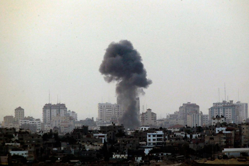 Black smoke rises after an Israeli air strike in the central Gaza Strip.