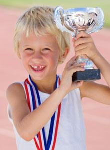 KID WITH TROPHY