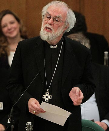 Dr Rowan Williams, the outgoing Archbishop of Canterbury speaks during a meeting of the General Synod of the Church of England at which the church decided against allowing women to become bishops.